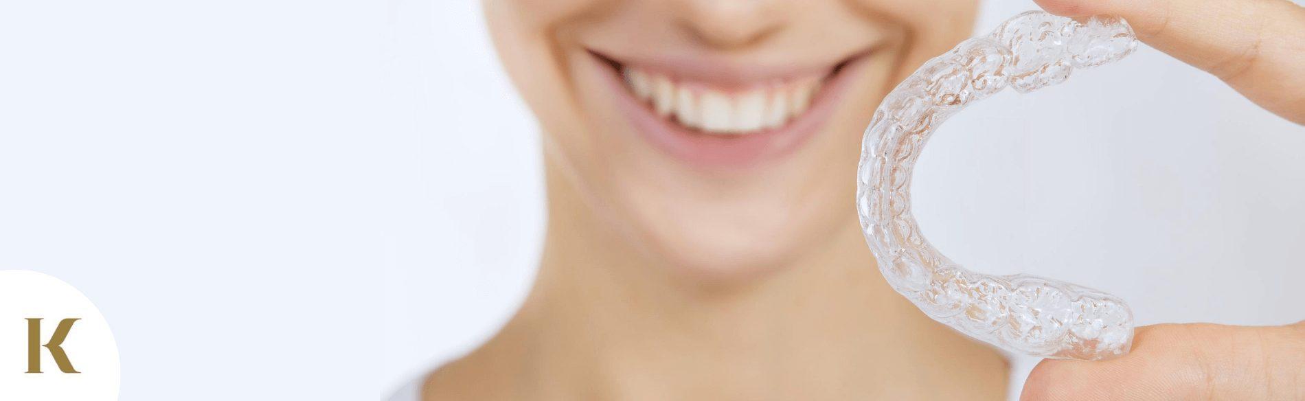 woman using tooth whitening kit